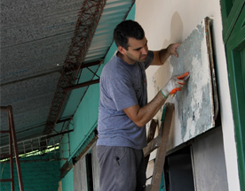 man-scraping-paint.jpg